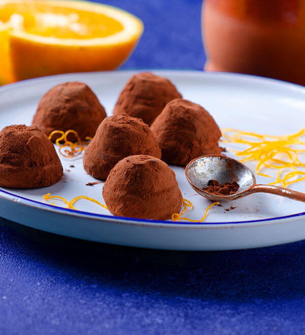 Chocolate orange truffles on plate