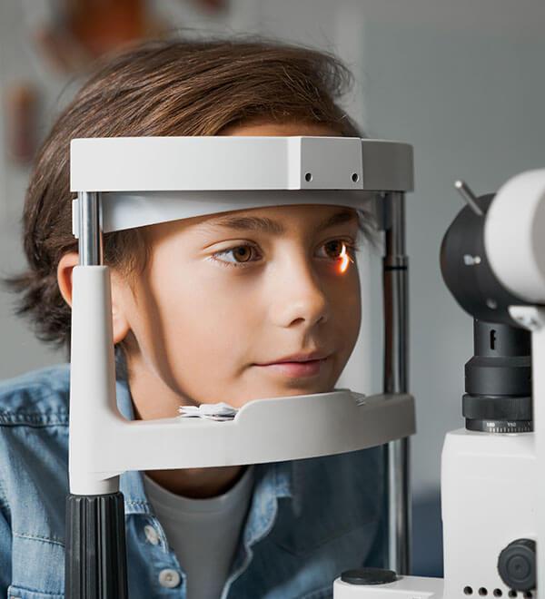 Young boy having an eye test