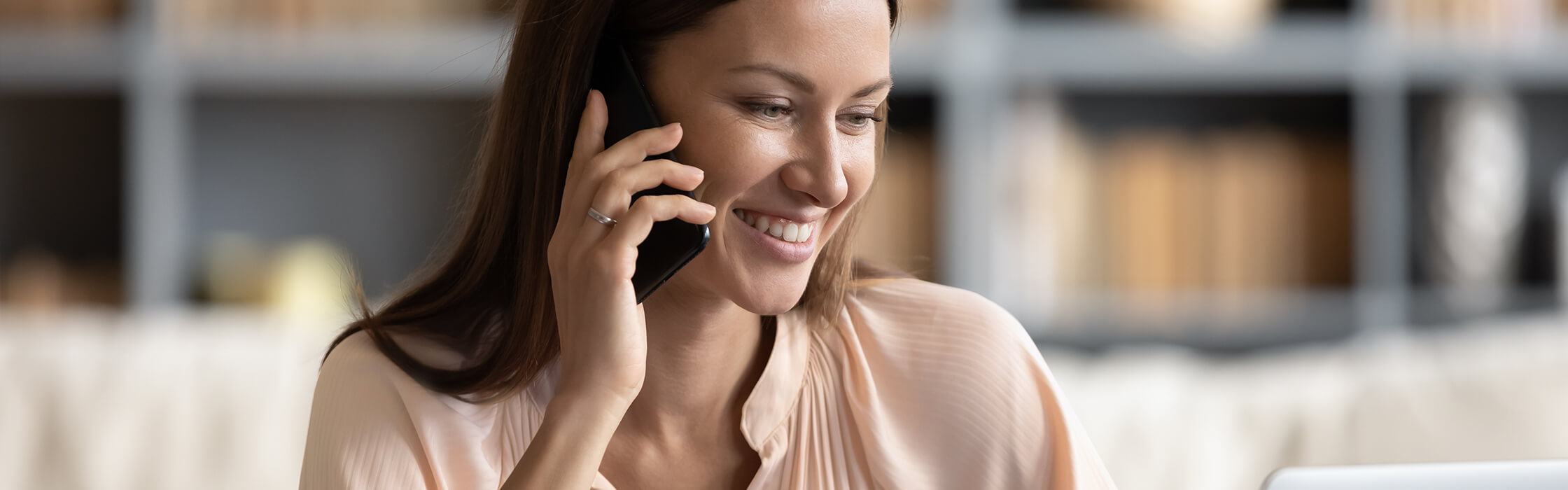 A woman smiling on the phone