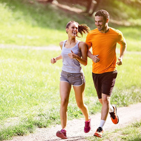 Summer sport couple jogging in the park