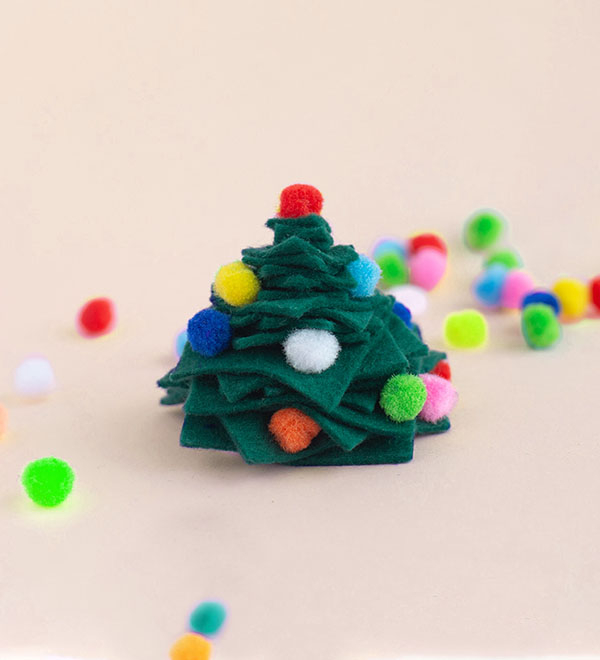Small felt Christmas tree with decorations