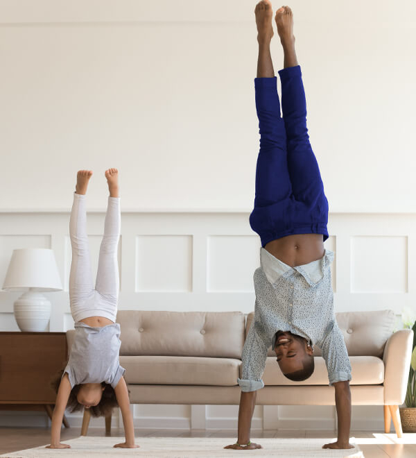 A father and child doing a handstand