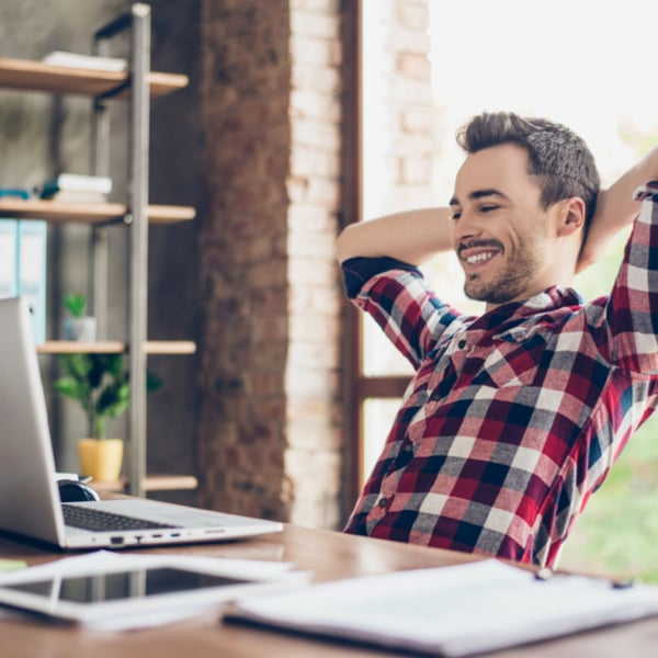Happy man comfortable at workstation