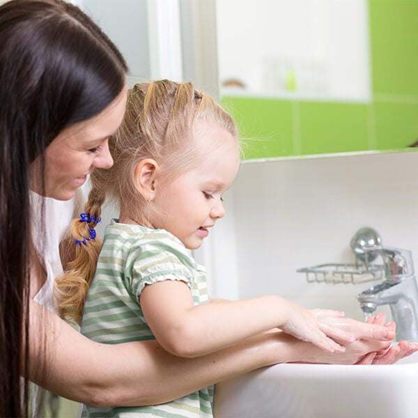 Young woman and child washing hands