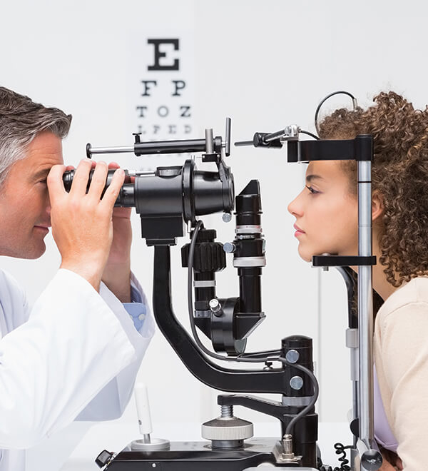 A woman having an eye test with an optician