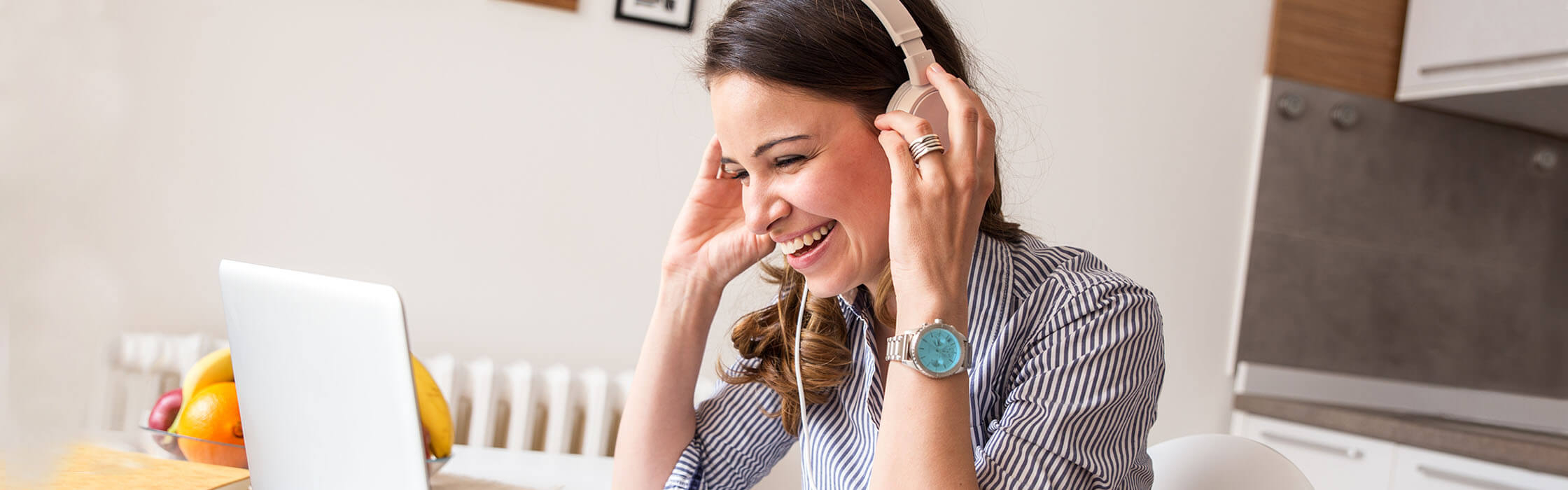 Woman on video call with headphones smiling