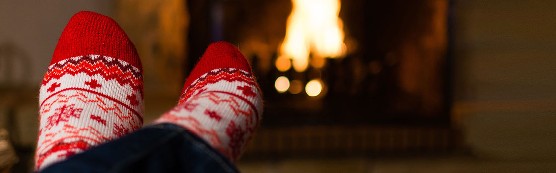 Cosy Christmas socks in front of fire