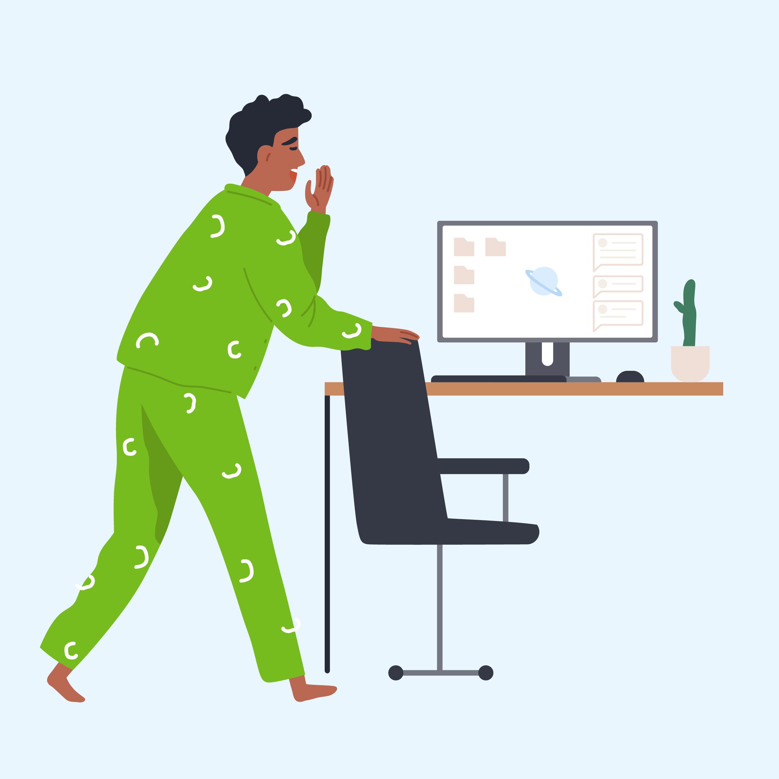 Worker in pyjamas standing by desk