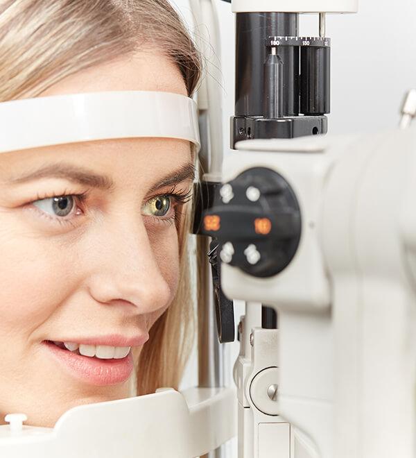 Customer looking through a tonometer