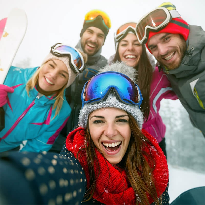 Happy group skiing with contact lenses
