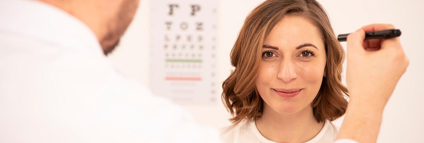Woman having an eye test at an optician's office