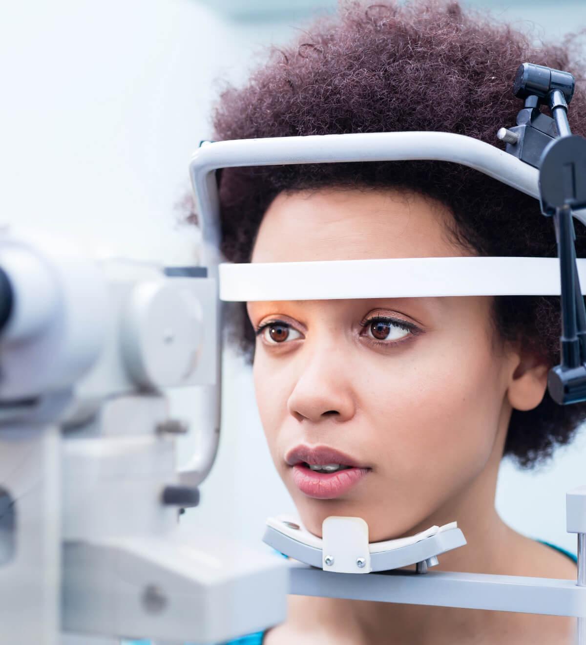 Optician conducting an eye test