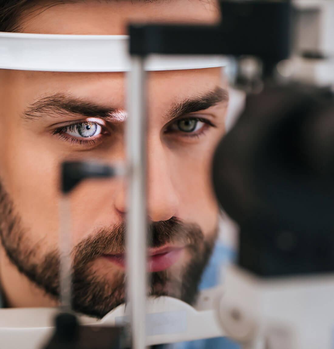 Man with tonometer during eye test