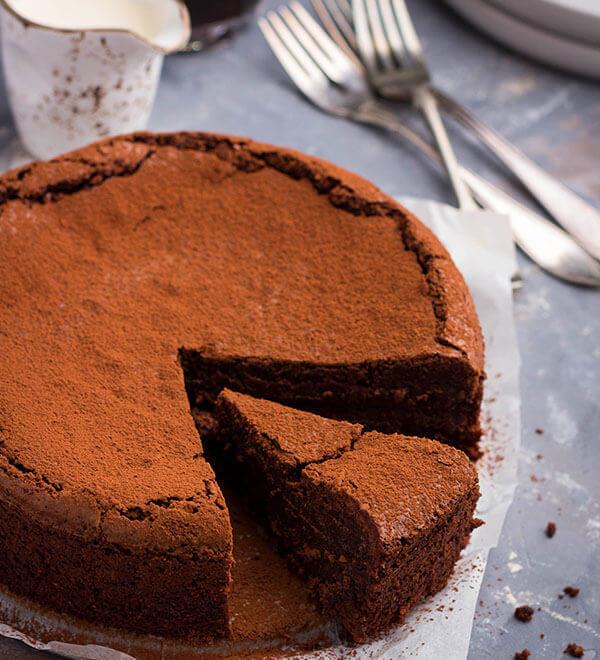 Flourless chocolate cake on table