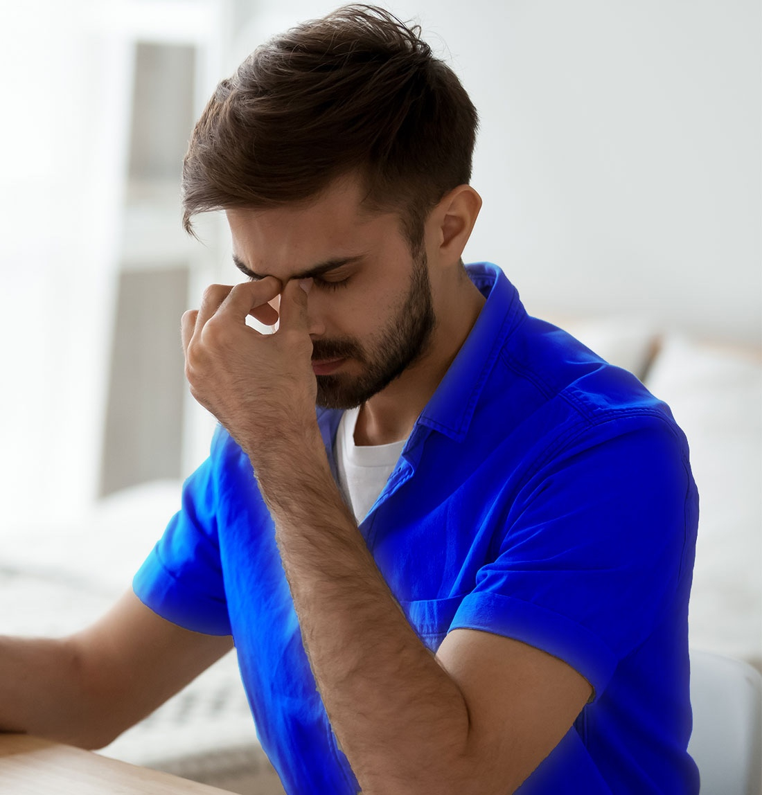 Man with eye strain after sleeping with contact lenses in
