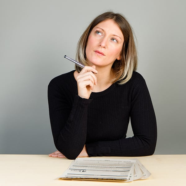 Woman considering whether to sign a contract